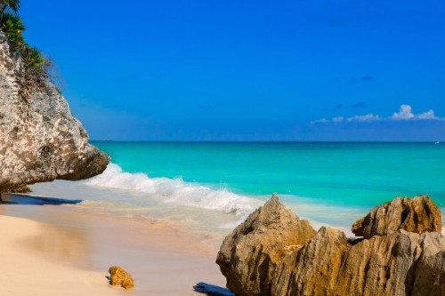Tulum Beach in Cancun with turquoise color water and blue skie